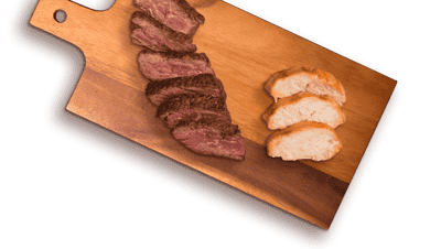beef and grilled chicken slices on cutting board