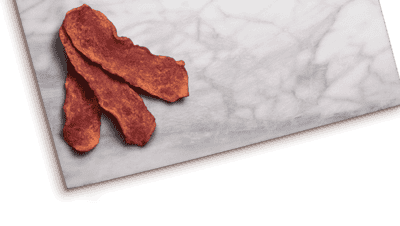 turkey bacon on a grey marbled cutting board