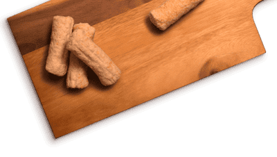Dognation chicken dog treats on a wooden texture