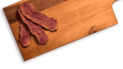 bacon slices on wood cutting board