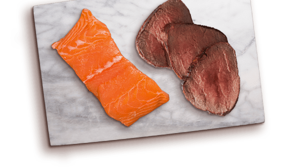 salmon and beef slices on marble board