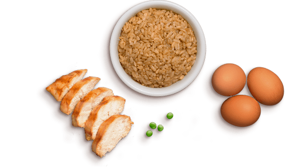 chicken slices, peas, brown rice in a bowl, three eggs