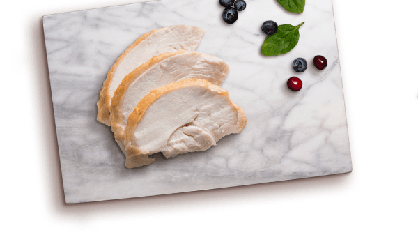 turkey slices, spinach leaves, cranberries and blueberries on marble board