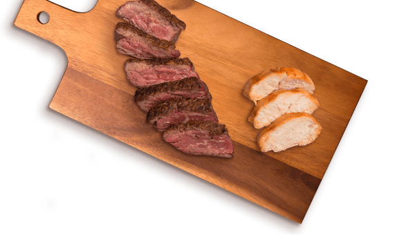 beef and chicken slices on cutting board