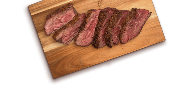 slices of beef on a wood cutting board