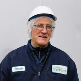 worker in freshpet blue jacket with safety glasses and white safety hat on