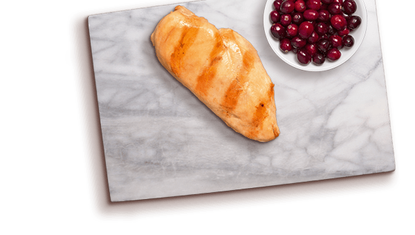 chicken slice and cranberries on a marble